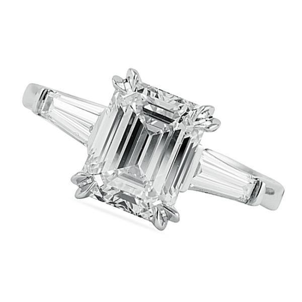 Platinum engagement ring with 3 carat Emerald diamond.