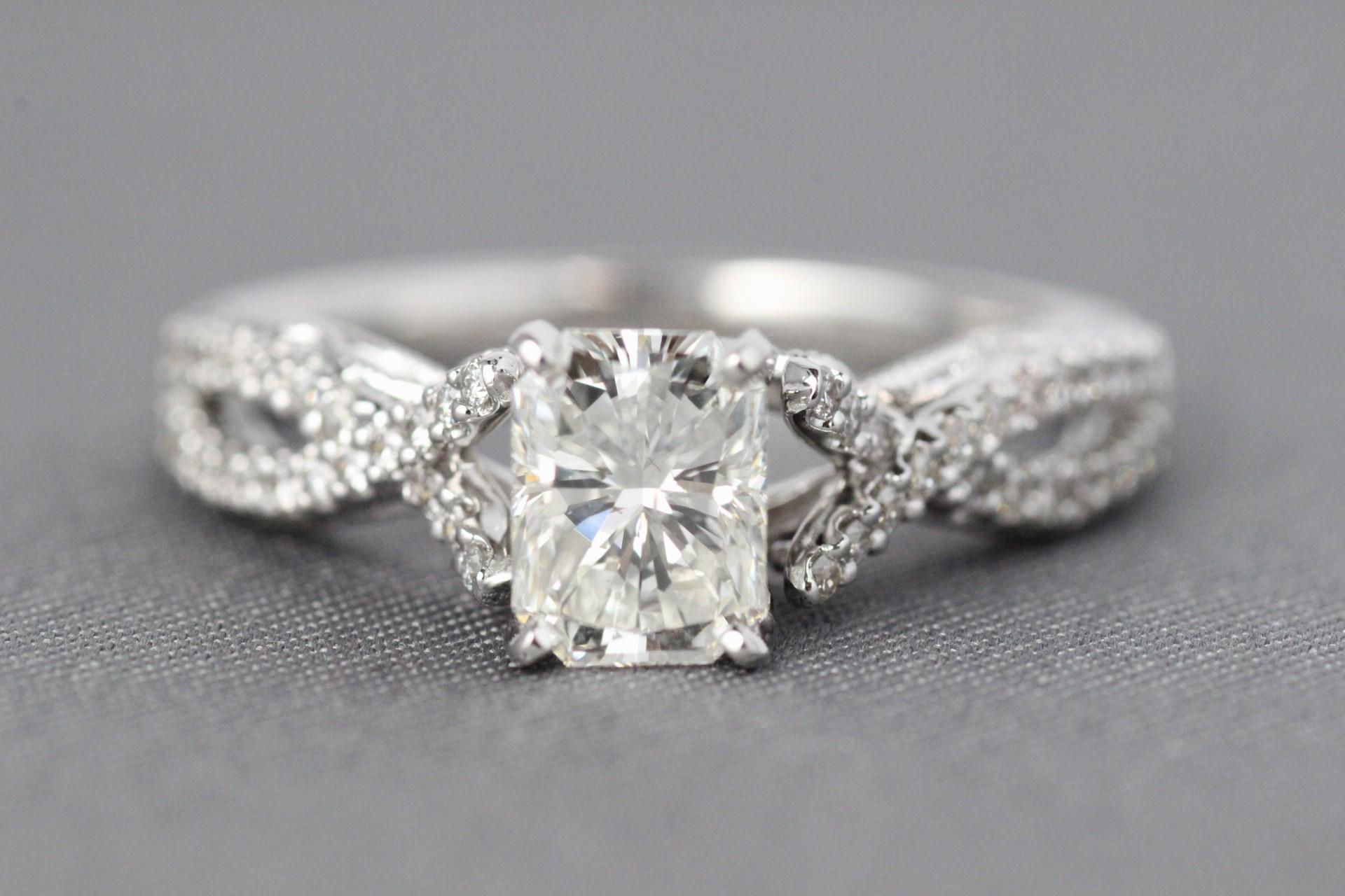 18 Karat diamond engagement ring with Radiant diamond.