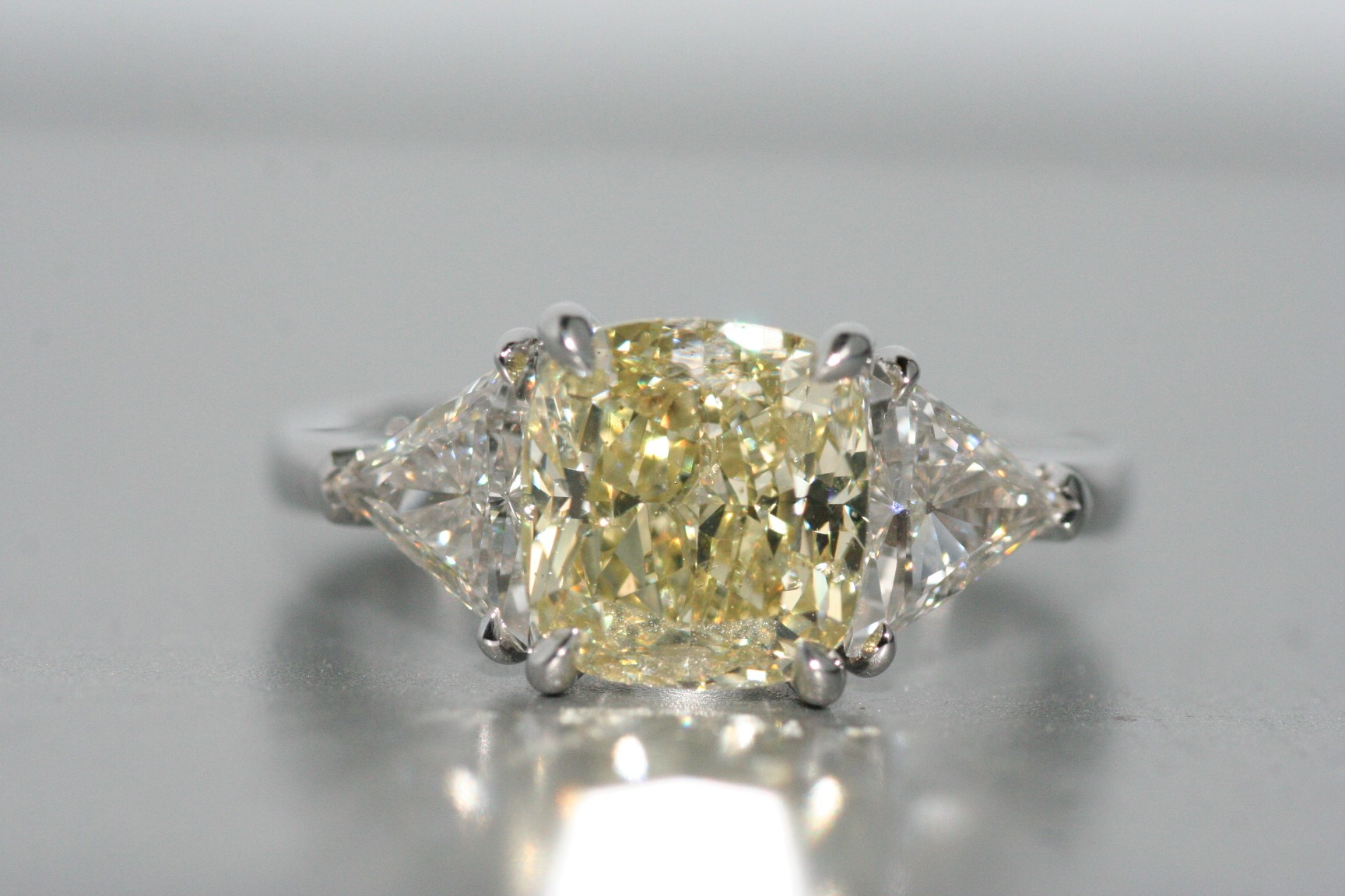 Platinum Fancy Yellow diamond ring.