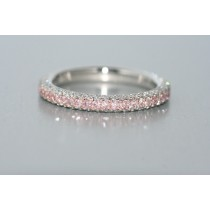 Platinum diamond eternity band with pink and white diamonds.