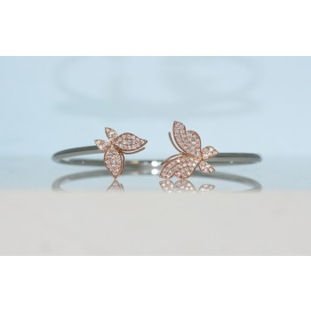 18 karat two tone diamond butterfly bangle.
