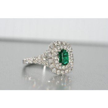 Platinum diamond and tsavorite halo ring.