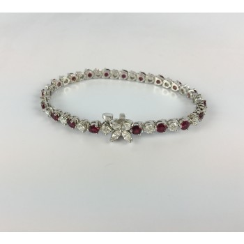 18 Karat White Gold Diamond and Ruby Tennis Bracelet.